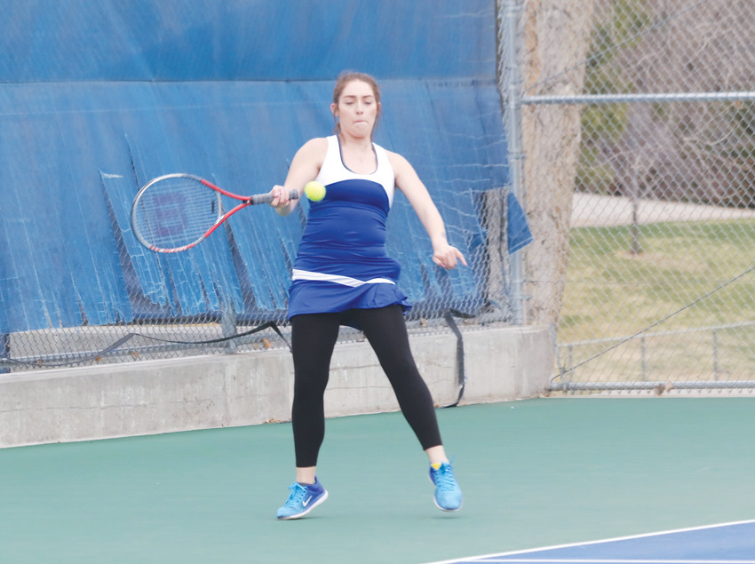 Senior Maryah Hoeft returns a serve as she warms up for her match against Conifer. Hoeft, who plays No. 2 singles for the Englewood girls tennis team, won her match against Conifer in three sets, 4-6, 6-1, 6-3.