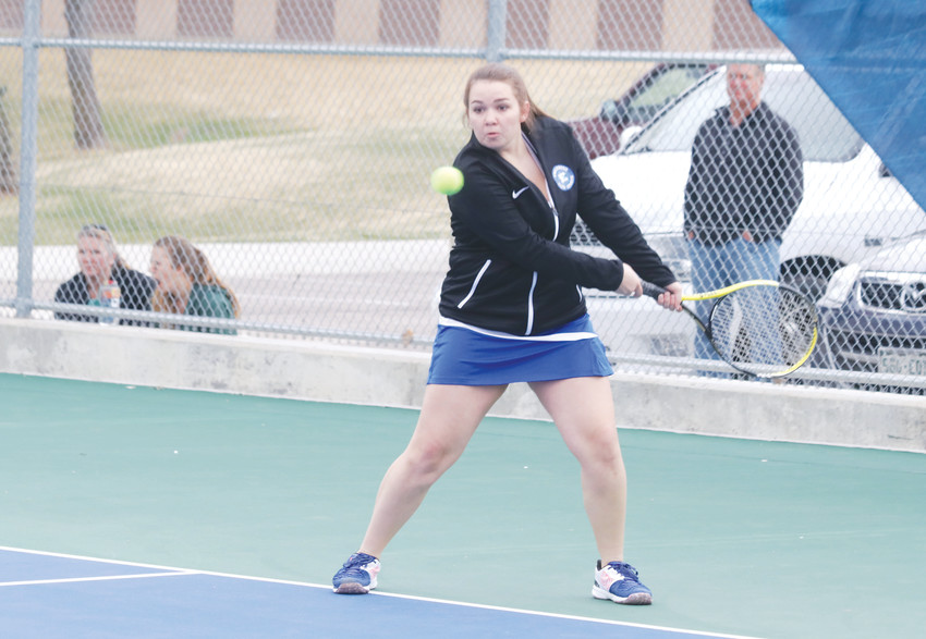 Mason Lores prepares to make a backhand return during her warmup for the April 5 Englewood girls tennis match against Conifer. Lores plays No. 1 singles for the Pirates.