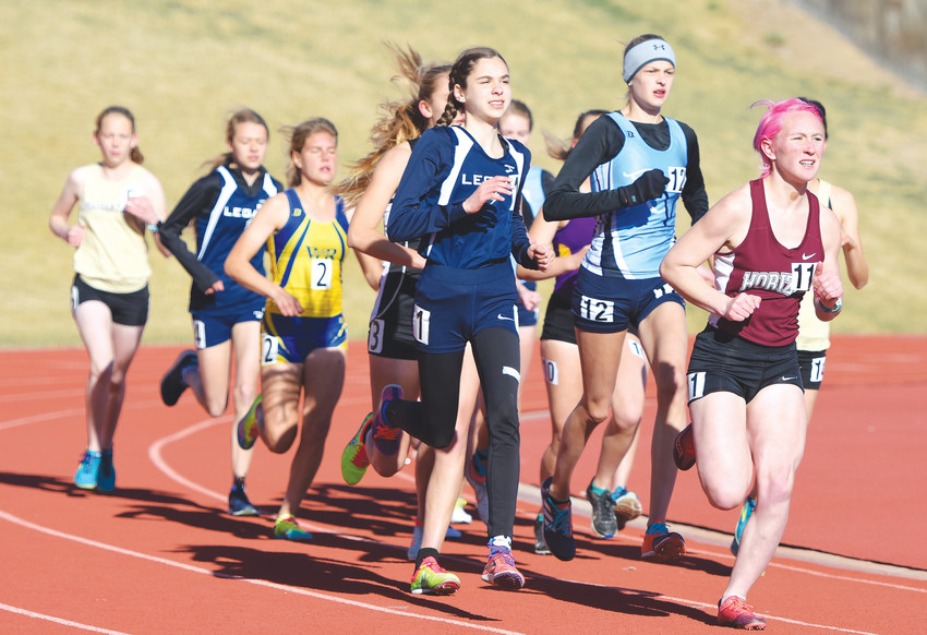 Horizon's Piper Morris, right, and Legacy's Brynn Stiles, center, set an early pace during the girls 3200-meter run, at the Mountain Range Invitational on April 14 at District 12 North Stadium in Westminster.