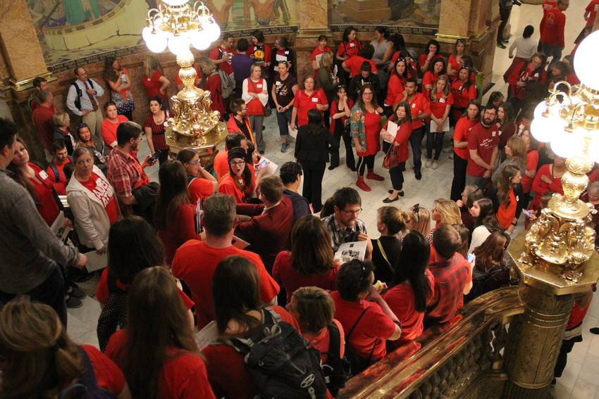 "The packed stairway at the state Capitol on a ""Day of Action"" for educators April 16. Teachers and other education personnel wore red in solidarity as they advocated for more school funding."