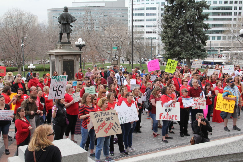 Educators hold a rally on the west steps of the state Capitol April 16. The group also marched on the Capitol grounds before entering the building around 10 a.m.
