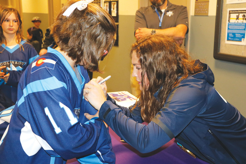 Gold-medal winner Nicole Hensley returned to the south Jeffco area for a skating event and to meet her fans on April 15. She signed autographs for a long line of fans such as 11-year-old Emily Levesque.
