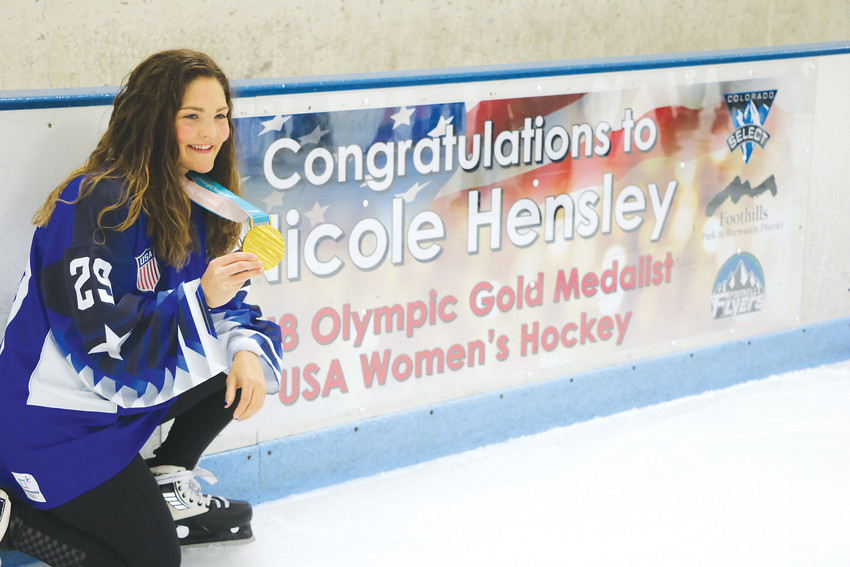 Olympic gold medal winner Nicole Hensley stopped by her former home ice on April 15 to skate with young hockey players and tell her story.