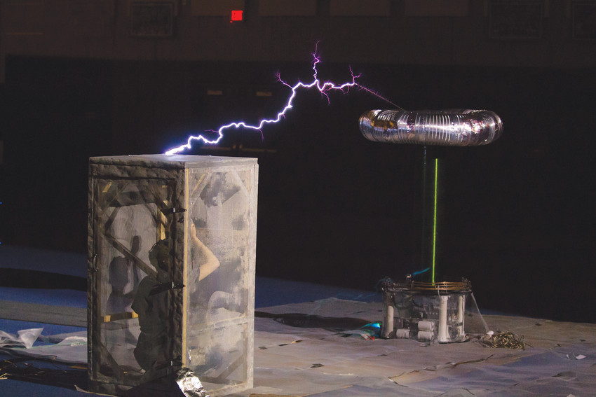 A Tesla Coil performance on Friday, the 13th was hopefully not unlucky for one person inside the cage being struck by lightning, during the annual E-Days activities.