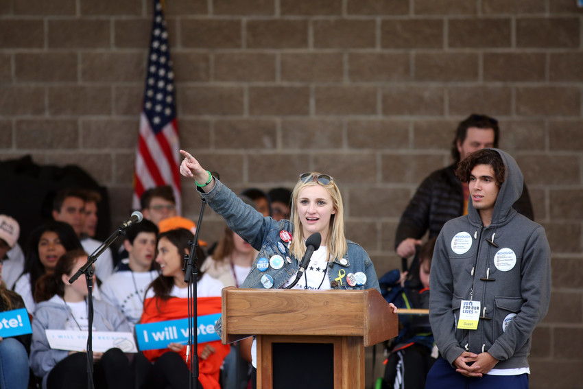 Golden High School student and Vote for Our Lives co-founder Emmy Adams gets the crowd fire up with a democracy chant.