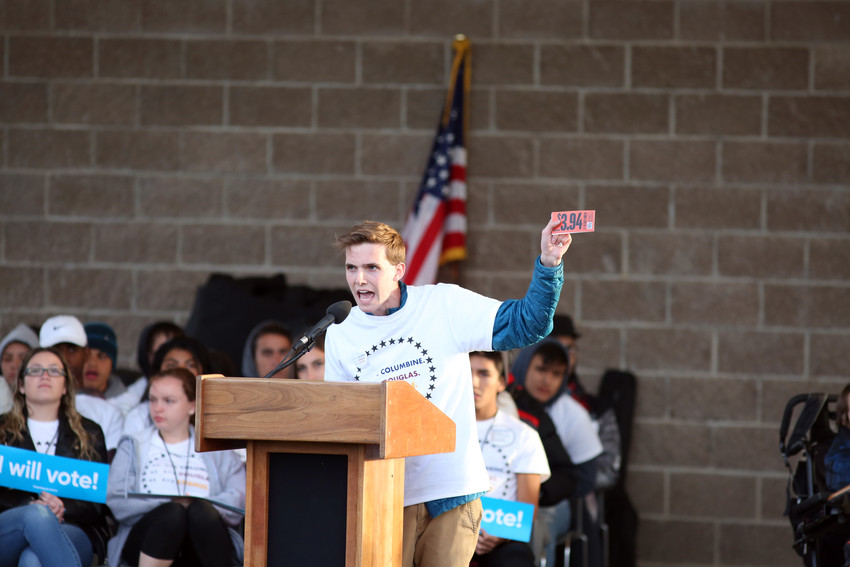 Sam Craig, Chatfield High School student and president of Jeffco Student United for Action, talks to the crowd about NRA funding and Colorado politicians.