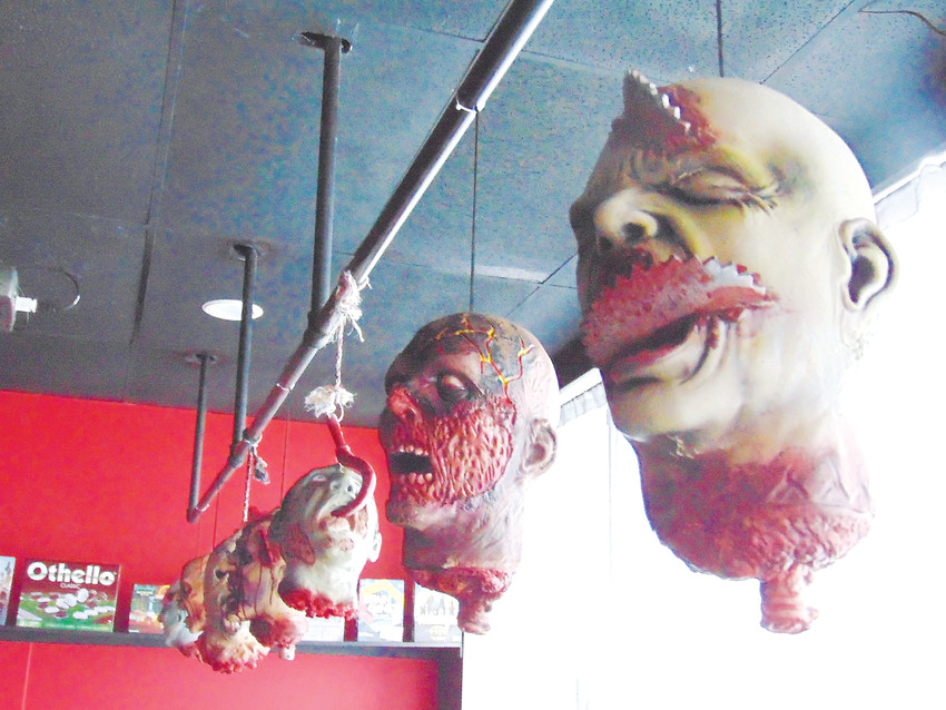 Impaled zombie heads hang from the ceiling of the Sanctuary social lounge, which is free and open to the public.