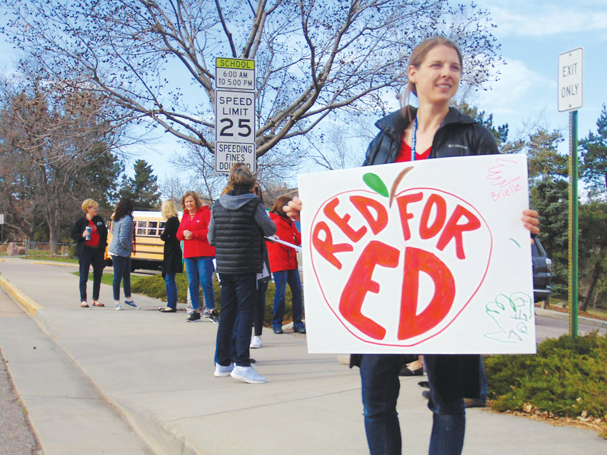 "Special education teacher Jenna Southern joins a ""walk-in"" rally to support increased education funding outside Runyon Elementary School on April 16. Southern said paltry state funding translates to overcrowding in her classroom."