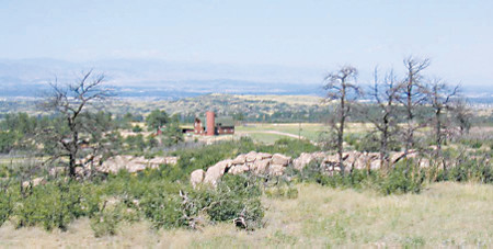 Daniels Park, with a view including buildings from Florence Martin's ranch, is seen from Riley's Hill in the park. Martin donated land for the park.