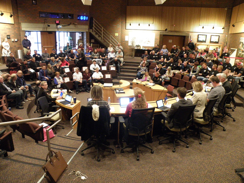 City council spoke to a packed house during a public hearing on the upcoming merger of the city's fire department with South Metro Fire Rescue on April 17. Many of the chamber's seats were filled by firefighters, who turned out to show their support for the proposal.