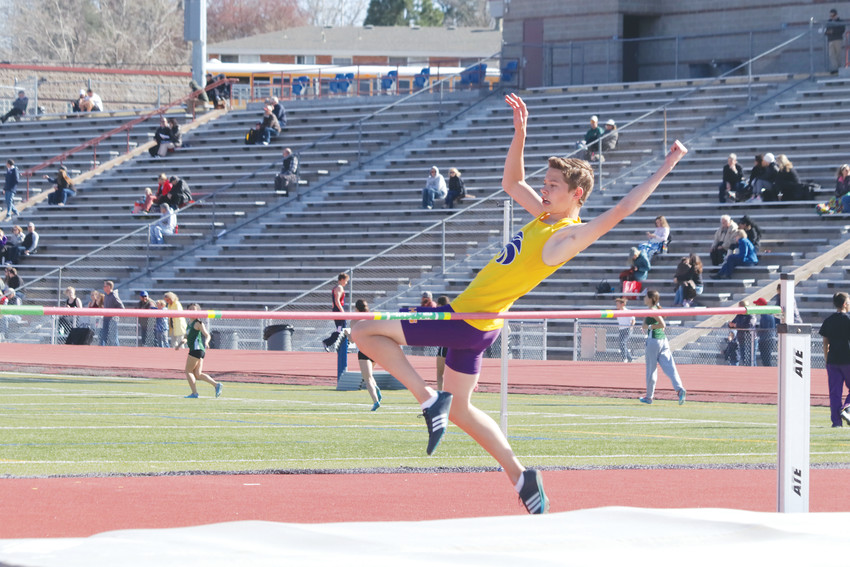 Gavin Valdez goes up and clears the bar at 5 feet during the April 18 triangular track meet at Littleton Public Schools Stadium. Littleton hosted the meet, which was rounded out by Chaparral and Mountain Vista high schools.