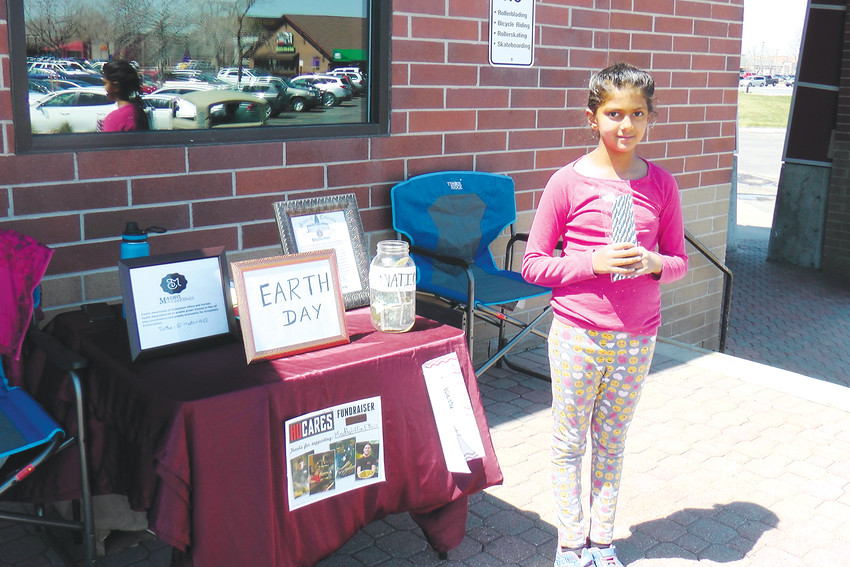 On Earth Day 2018, Arvada grade-schooler Madhvi Chittoor distributed paper straws to create awareness in front of the HuHot restaurant at the Centerplace Shopping Center on 52nd and Wadsworth.