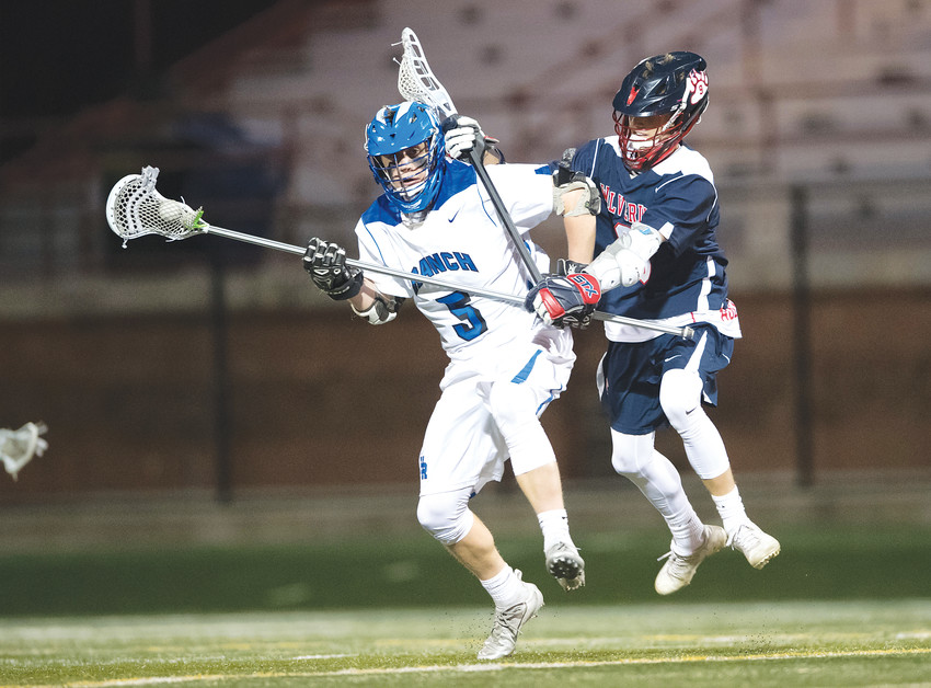 Chaparral's Blake Platt, right, jumps in the path of Highlands Ranch's Brody Rule. The teams squared off at Shea Stadium in Highlands Ranch on April 19, with Highlands Ranch ending up on top, 12-9.