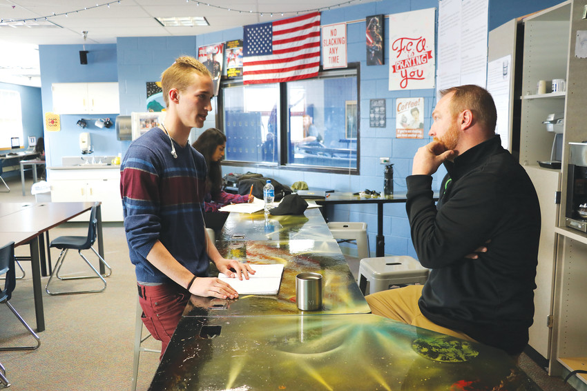 Highlands Ranch High School junior Tennissen Rockett, left, talks to Bas Wolfe , who teaches the  school's Alternative Cooperative Education, or ACE, program, which helps prepare students for career paths and post-secondary education. With a focus on mental health, students learn about their personal strengths and needs.