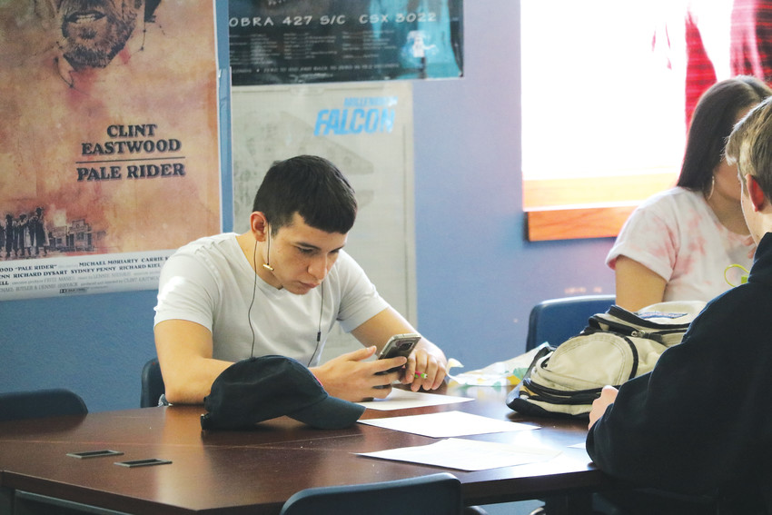 Dmitri Ramos, a senior at Highlands Ranch High School, checks his phone in class. Many of his peers often do the same. A national study in 2015 says nearly three-quarters of teens had a smartphone or had access to one, and 94 percent of teens went online with a mobile device daily.