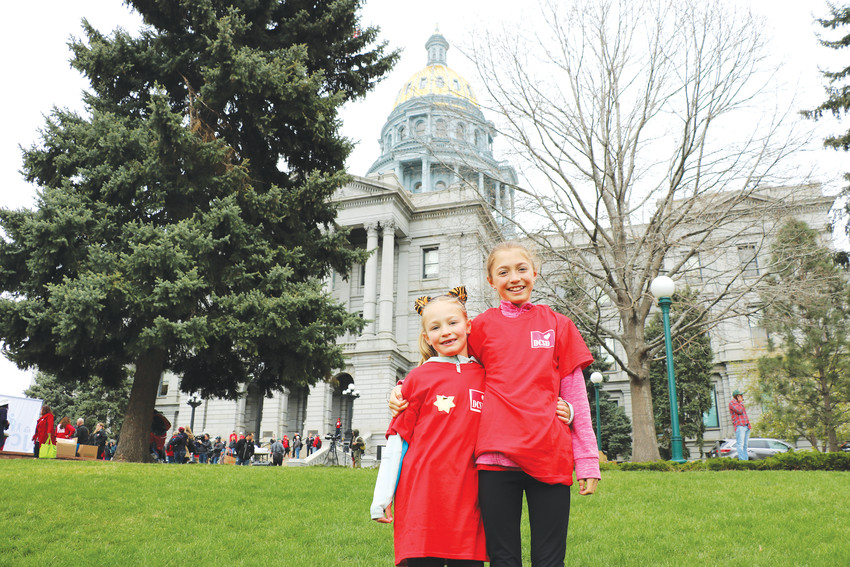 "Elina Asensio, 12, left, and her sister Zoe, 7, attended the April 26 rally at the state Capitol with their mother in support of their teachers at Northridge Elementary School. ""When everyone comes out like this, it feels like we are a bigger voice,"" said Elina, ""and we will make a difference."""