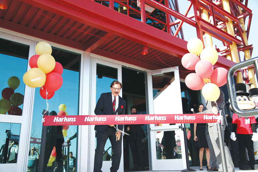 Dan Harkins, owner of Harkins Theaters, cuts the ribbon to signify the grand opening of Harkins Arvada 14 on April 26.