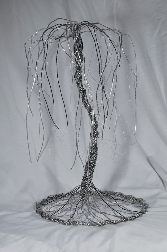 Kasey Heap, a senior at Elizabeth High School, won a $500 scholarship with the tree she designed and constructed using only wire.