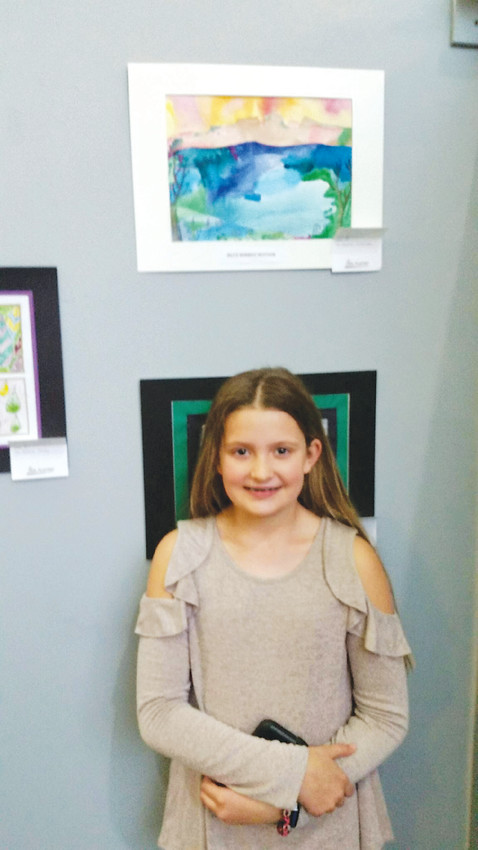 Fifth-grader Montana Webster drew from her surroundings and loved ones to create an imaginative Colorado landscape and earned best in show.