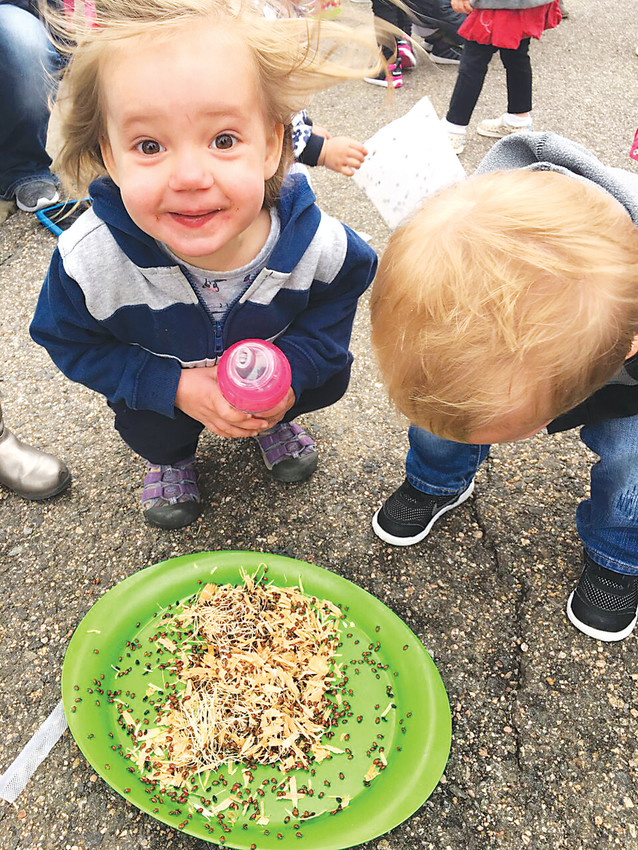 Young students at Riverstone Education in Lone Tree marvel at thousands of lady bugs they released to celebrate Earth Day.