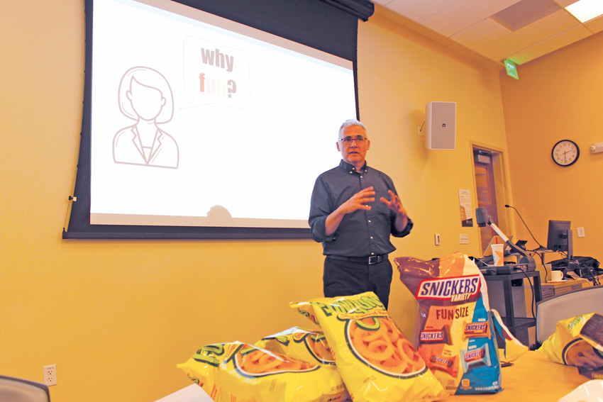 David Thomas Ph.D., owner of Buzzcut and director of academic technology at the University of Colorado-Denver, speaks to a crowd about the benefits of increasing fun in the workplace.