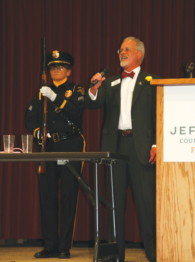 Donald Tallman, right, the executive director of the Colorado Railroad Museum, sings the national anthem following the Honor Guard's presentation of colors at the 28th annual Good News Breakfast on April 24.