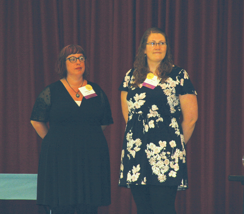 Stephanie Douglas, left, an adult librarian, and Lauren Reed, a patron experience associate, represent the Jefferson County Public Library at the 28th annual Good News Breakfast on April 24. The library was honored for its Girls in Stem program.