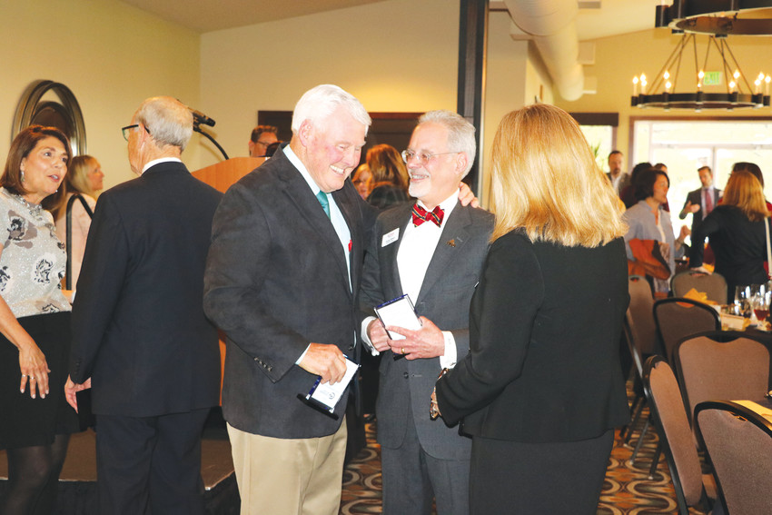Hall of Fame inductees John Bandimere Jr. and Donald Tallman share a laugh with West Metro Chamber Director of Development Nancy Miller following their induction ceremony on April 24.