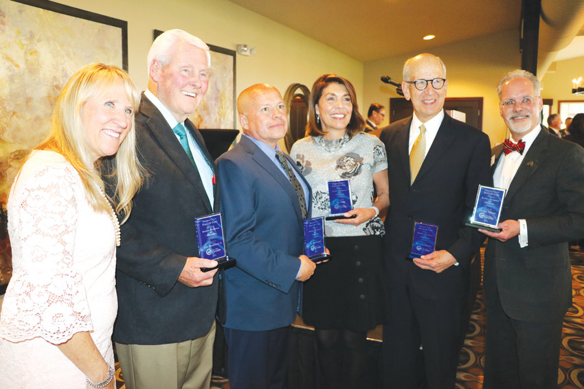 Pam Bales, the West Metro Chamber's CEO and president, with the five inductees into the West Metro Chamber's Hall of Fame — from left, John Bandimere Jr., David Goff (standing in for Dr. Harriet Hall), Fran Baker, Steve Burkholder, and Donald Tallman.