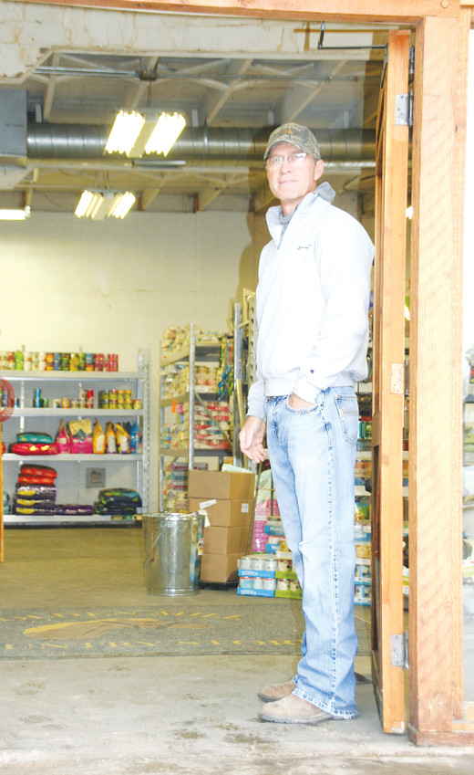 John Boyle stands in the entrance of the Golden Mill in April during the last couple of weeks that the feed store was open. Boyle, 60, began working at the Golden Mill in 1978 and took over ownership in 2003.