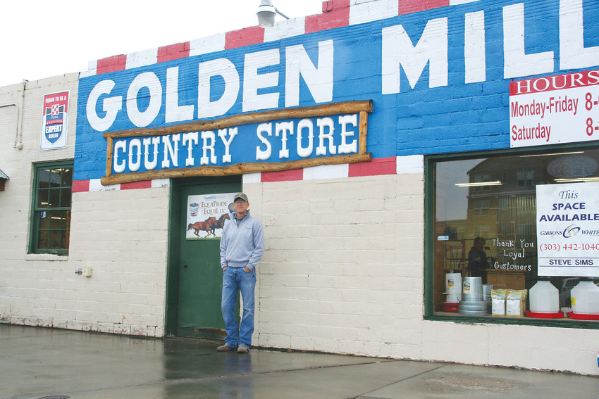 Owner of the Golden Mill John Boyle stands outside of the Golden Mill before it closes its doors near the end of April. The Golden Mill, 1012 Ford St., first opened as a flour mill in February 1865 and has been operating as a feed store since the 1950s.