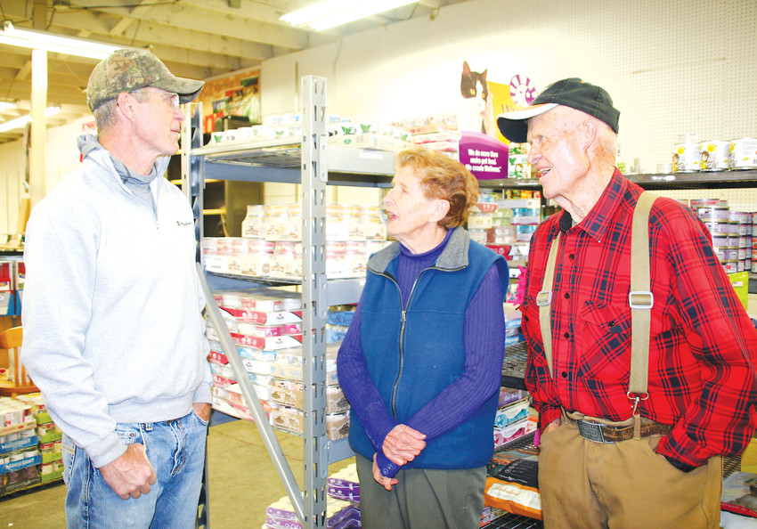 John Boyle, owner of the Golden Mill, left, swap memories of the store's history with some of his longtime customers, Mary and Charles Ramstetter, on April 24 at the feed store at 1012 Ford St. in Golden.