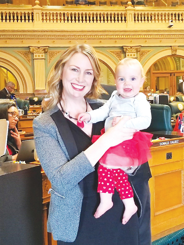 State house representative Jessie Danielson poses with her daughter, Isabelle, at the state capitol on Equal Pay Day, April 10. Danielson is sponsoring the bill Equal Pay for Equal Work Act, which recently passed the House.
