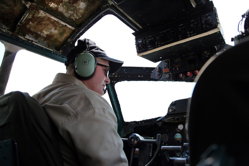 "Pilot Scott Maher, director of flight operations for The Liberty Foundation, prepares for takeoff in the ""Madras Maiden,"" a World War II B-17."