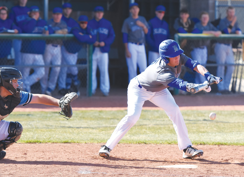Broomfield's Ben Peterson attempts to lay down a bunt during an April 18 game at Mountain Range High School in Westminster.