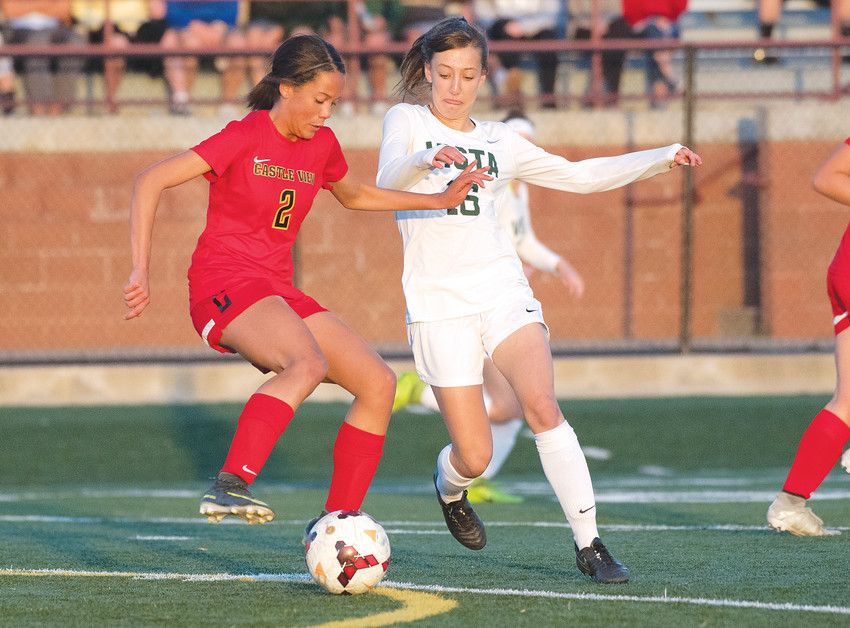 Castle View's Riley Baker, left, vies for ball control with Mountain Vista's Katy Desrosiers. The Golden Eagles came out on top, 4-0, April 26, at Shea Stadium in Highlands Ranch.