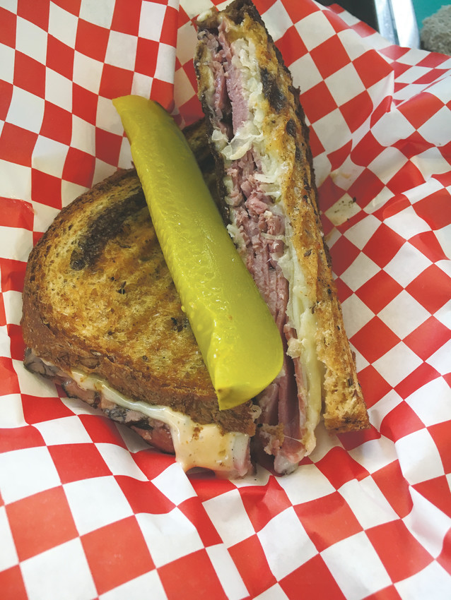The Comforts of Home Food trucks signature panini sandwich is a Cuban, with pork, bacon swiss cheese and spicy pickles and mustard aioli.