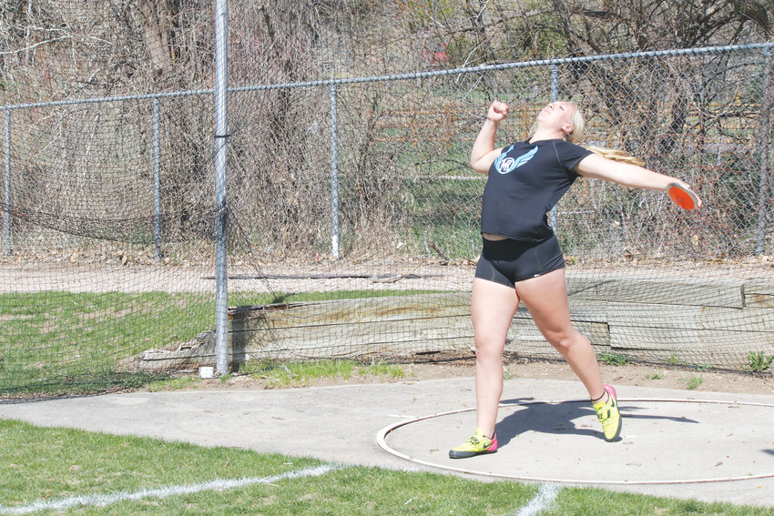 Mountain State senior Amber Gustason practices her form as she prepares to compete in the discus event at the April 27 portion of the Liberty Bell Track Meet. Gustason won the discus event with a throw of 122 feet, four inches. The next day she won the meet shot put event with a throw of 37 feet, six inches. The points she earned help the Mustangs finish 13th with 24 points in a field of 40 girls teams.