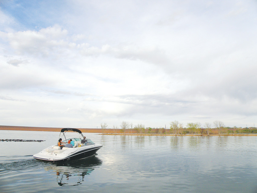 Boaters head out to open water from the Chatfield Reservoir marina. A plan to raise the maximum possible water level by 12 feet means the marina will have to move to higher ground later this year.