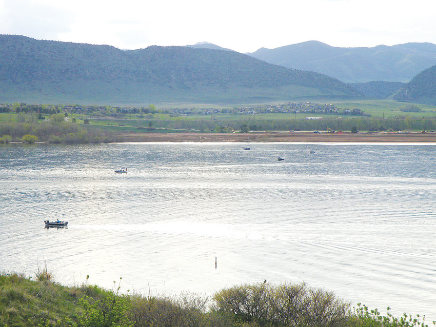 Boaters zip across Chatfield Reservoir. A plan to raise the maximum possible water level by 12 feet means shoreline amenities will have to move to higher ground.