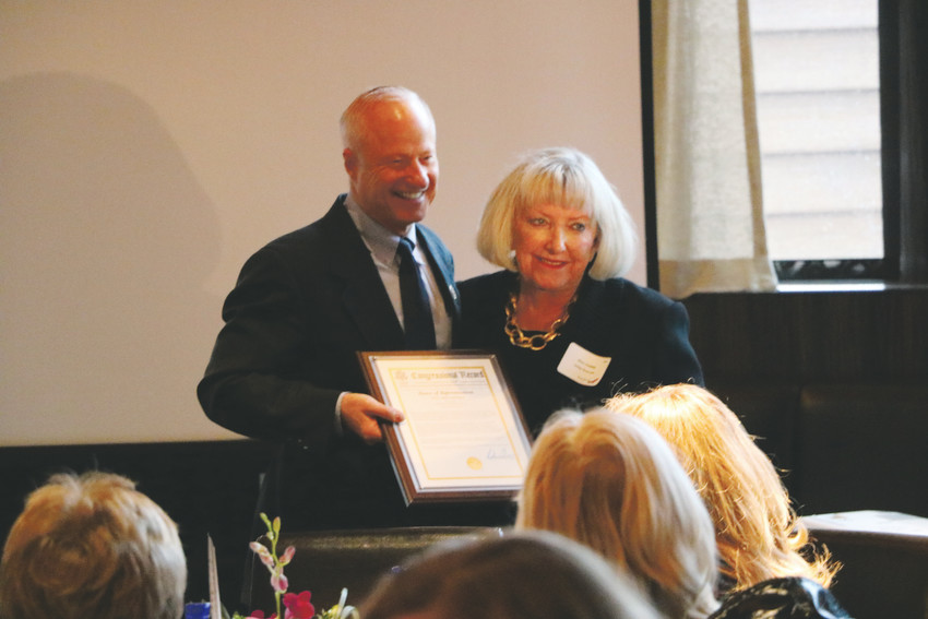 "U.S. Rep. Mike Coffman, R-Aurora, presents Diane Smethills, principal of Sterling Ranch, with a ""Women Who Soar"" award at a ceremony on May 3 at Perry's Steakhouse & Grille in Lone Tree. The Highlands Ranch Chamber of Commerce hosted the event to recognize three influential women in the Denver metro area."