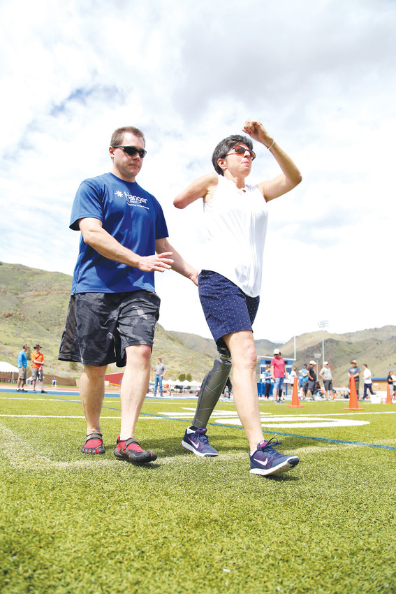 Ilene Brandon, of Highlands Ranch, works on walking with a Hanger Clinic coach. She has been an amputee for six years and wants to remember how to run.