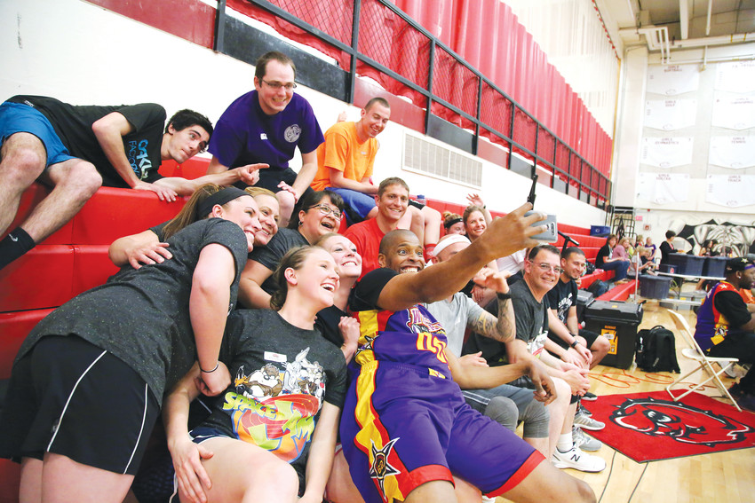 "Harlem Wizard Dwayne ""Swoop"" Simpson takes a selfie with Arvada teachers before the fundraising game."