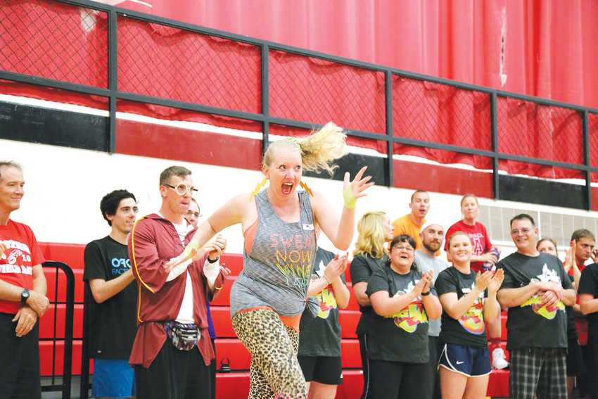 Foster Elementary School teacher Carissa Soto Rodriguez dances it out before the basketball game.