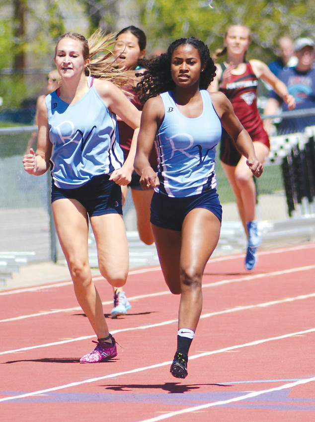 Ralston Valley junior Maya Provencal, right, edged teammate Zoe Beauchamp during the finals of the Class 5A girls 400 meters May 5 at Jeffco Stadium. Provencal swept the 5A girls' 100, 200 and 400 at the Jeffco League Track and Field Championships.