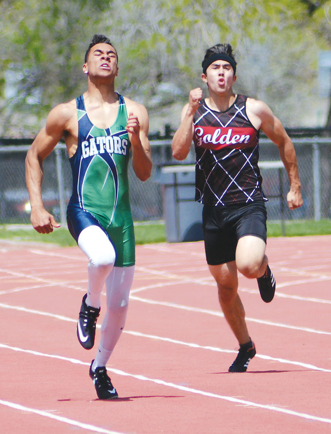 Standley Lake junior Tyler Williams, left, sprints down the home stretch with Golden junior Nicholas Arner during the finals of the Class 4A boys 200-meter run May 5 at Jeffco Stadium. Williams won the 100, 200, 400 and was on the Gators' 4x200 relay team that won at the Jeffco League Track and Field Championships.