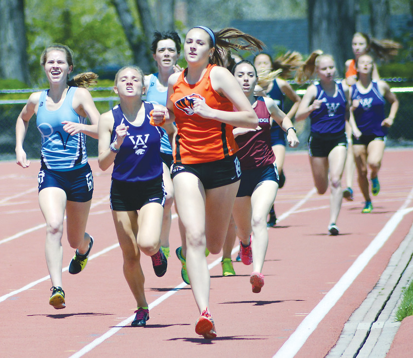 Lakewood senior Jessica Woodhead leads the pack of runners during the Class 5A girls 800-meter run May 5 at Jeffco Stadium. Woodhead won in a time of 2:25.27. Woodhead's teammate, junior Carley Bennett swept the 1,600 and 3,200 events at the Jeffco League Track and Field Championships.
