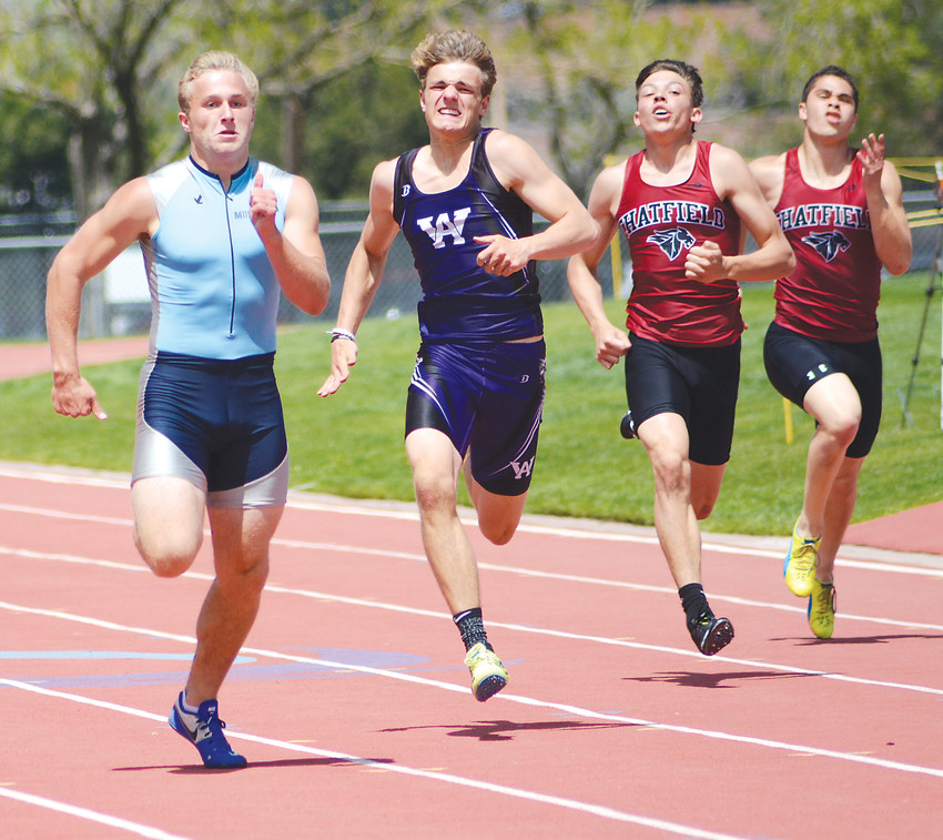 Ralston Valley junior Brad Roberts, far left, has a slight lead on Arvada West's Nicholas Nuhfer, along with Chatfield's Josh Cronin and Hunter Barnes during the home stretch of the Class 5A 200-meter dash May 5 at Jeffco Stadium. Roberts finished second to Dakota Ridge senior Kyle Scofield.
