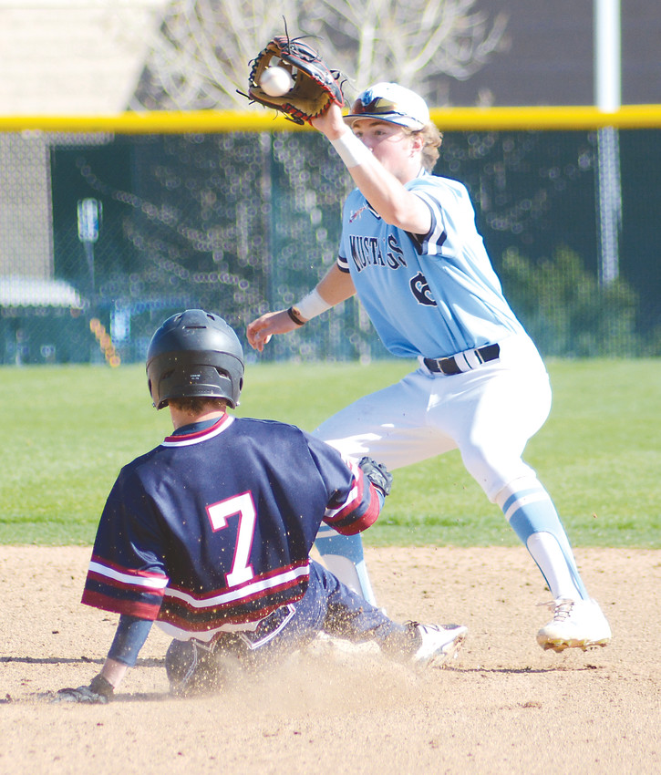 Ralston Valley junior Trey Adams receives the ball and tags out Dakota Ridge junior Henry Fox on a steal attempt May 4 at Nate Jurney Field. The Mustangs rallied for a 5-4 victory by scoring five runs in the final two innings.