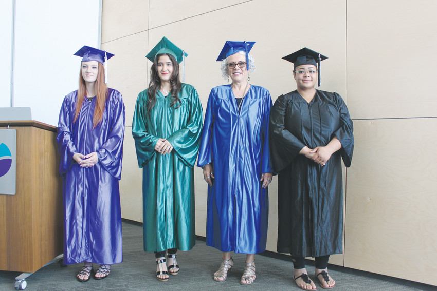 From left, Skylar Nelson, Sunita Safi, Elena Sainz and Kiama Jenkins received their GEDs May 6 during the Douglas County High School Equivalency graduation ceremony.